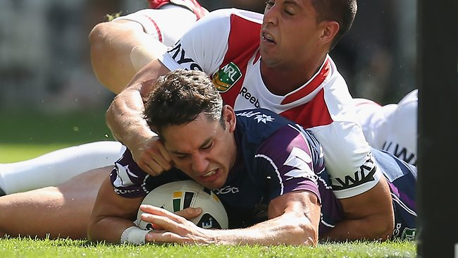 Billy Slater of the Storm scores the first try of the game.