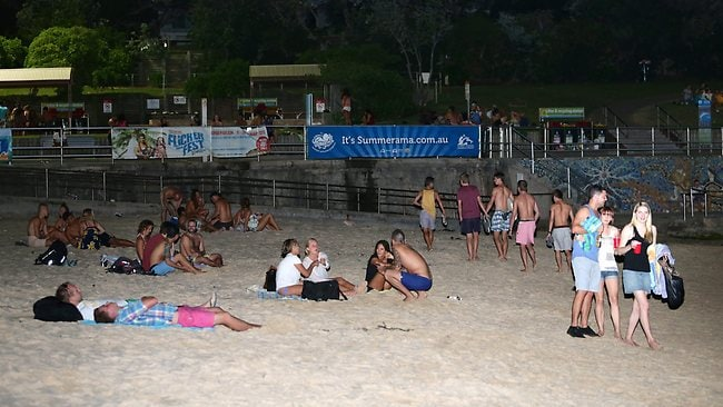 People packed Bondi Beach to escape the heat last night. Picture: Bill Hearne