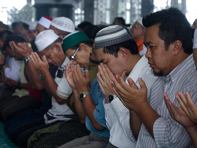 Power of prayer ... Members of the public, Malaysia Airlines staff, and politicians pray during a special prayer as the search for missing Malaysian airline MH370 expands to the Indian Ocean March 14, 2014 in Kuala Lumpur, Malaysia.