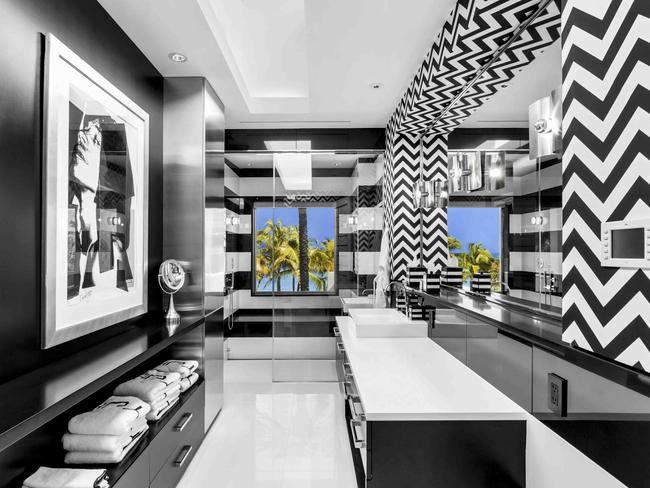 The psychedelic home boasts seven bedrooms and 12 bathrooms, including a master suite with a black-and-white striped bathroom.