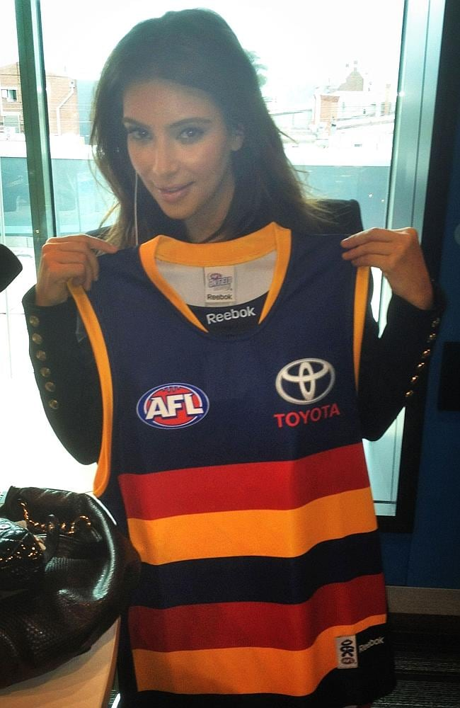Socialite Kim Kardashian with an Adelaide Crows guernsey sent to her by SAFM breakfast announcers Hayley Pearson and Angus O'Loughlin.