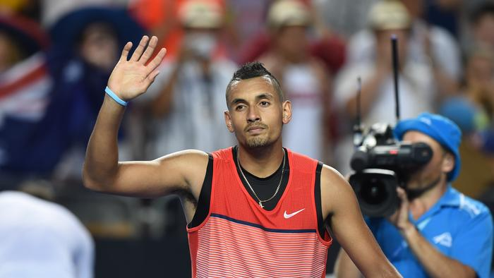 Nick Kyrgios gestures to the crowd after winning his match against Pablo Carreno Busta.