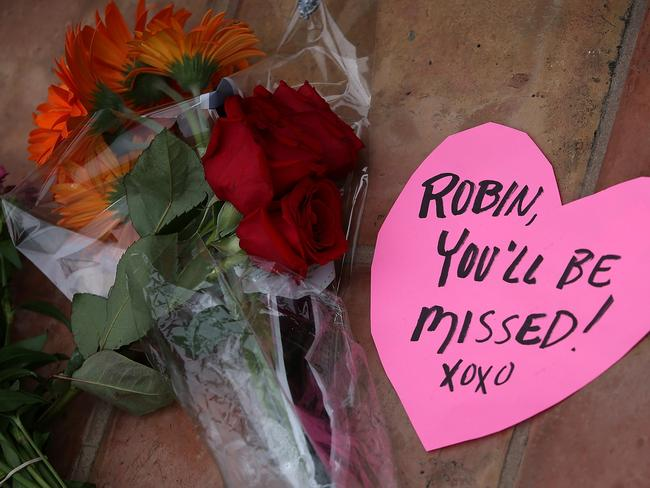 Touched hearts .. flowers sit in front of the home of actor and comedian Robin Williams on August 12, 2014. Picture: Justin Sullivan