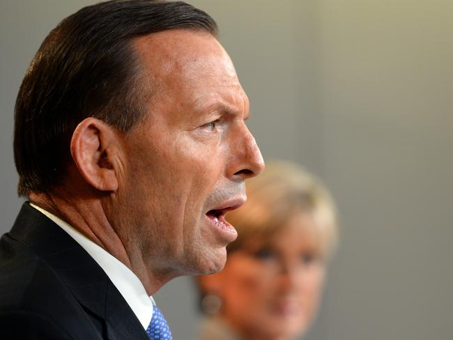 Oh spit it out Tony. Julie Bishop watches on. Pic: AFP.