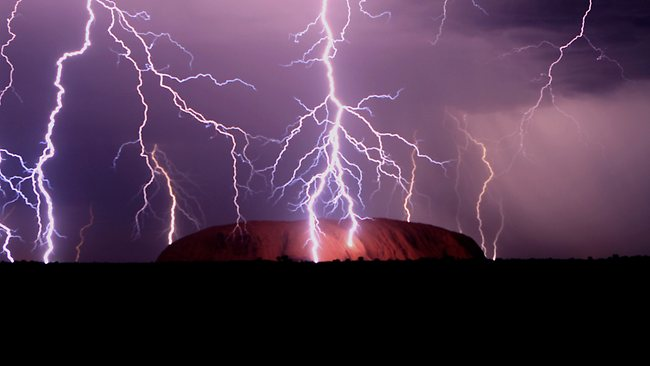 "Photographer Damien Hill from Uluru Photography captured the multi lightning strikes over Uluru in the Northern Territory and its vast surroundings. Frommers reckons the site is ""more magnificent than you can imagine"". Picture: Damien Hill"