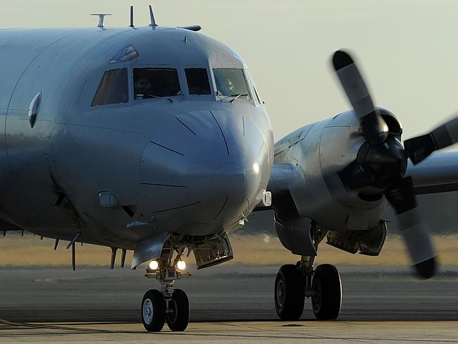Looking...An Australian Orion aircraft arrives back at Pearce Airbase in Bullsbrook, 35 kms north of Perth after assisting in the search for missing Malaysia Airlines Flight MH370. Picture: AFP