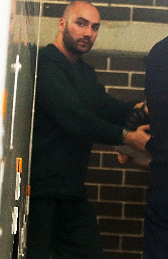 Suspended police officer Senior-Constable Ashur Oshana is taken in handcuffs from a prison truck to court yesterday / Picture: John Grainger