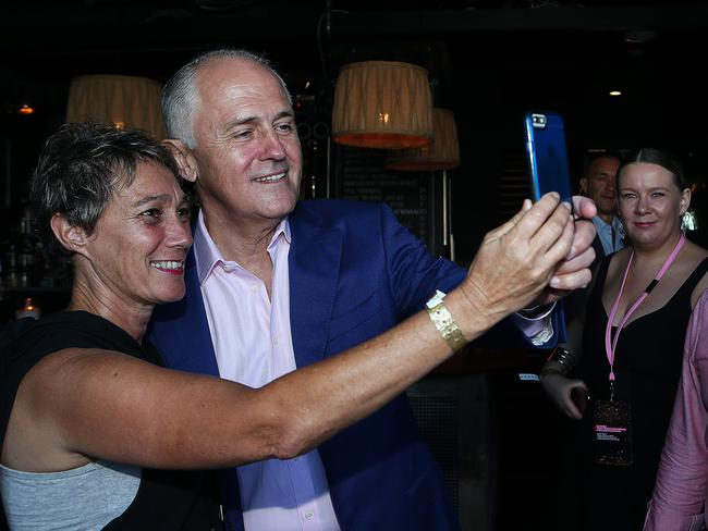 Prime Minister Malcolm Turnbull and wife Lucy, arrive at Kinselas to enjoy the mardi gras parade. Picture: Kristi Miller