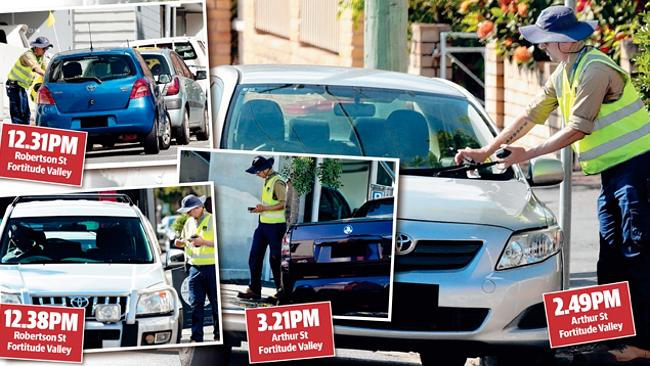 A parking inspector does a brisk trade in Brisbane's Fortitude Valley.