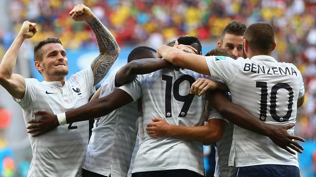 France players celebrate Paul Pogba's goal.