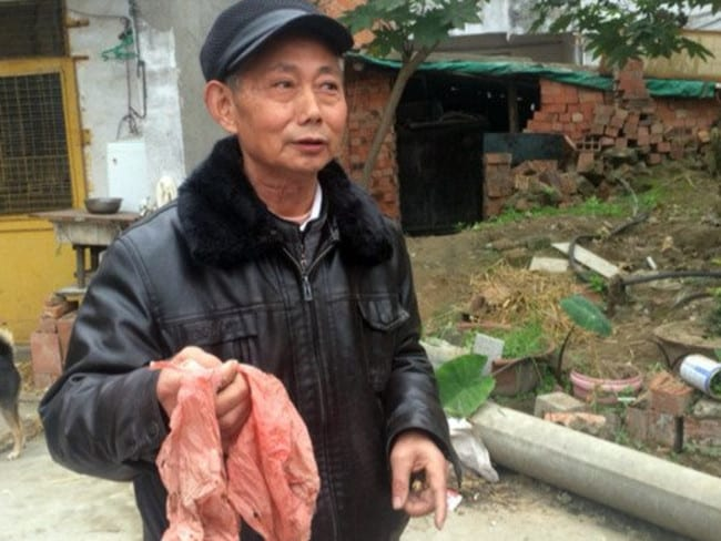 Shocked ... Wu Chen with the biodegradable bag he buried his savings in. Picture: People's Daily Online