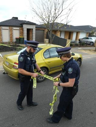 Police at the Andrews Farm address. Picture: Tait Schmaal.