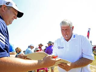 SHEBOYGAN, WI - AUGUST 12: John Daly of the United States signs an autograph for a fan during a practice round prior to the 2015 PGA Championship at Whistling Straits on August 12, 2015 in Sheboygan, Wisconsin. (Photo by Jamie Squire/Getty Images)
