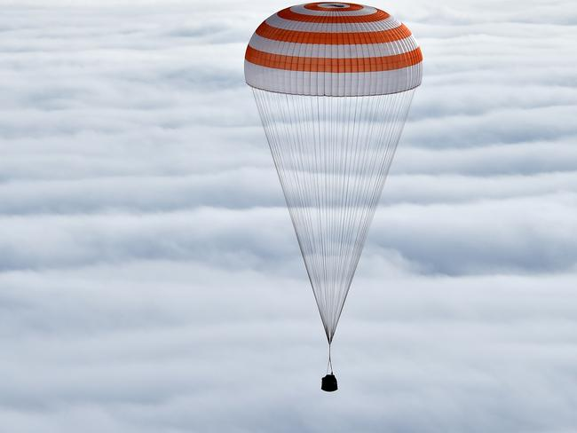 Back to Earth ... Russia's Soyuz TMA-18M space capsule carrying the International Space Station (ISS) crew members prepares to land in a remote area outside the town of Dzhezkazgan, Kazakhstan. Picture: AP