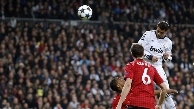 UEFA Champions League, round of 16: Real Madrid's Cristiano Ronaldo heads the ball to score against Manchester United in Madrid. Picture: Cesar Manso