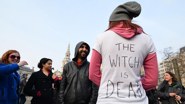"A woman wears a t-shirt with the slogan 'The Witch is Dead' during an anti-Thatcher 'gathering' in Trafalgar Square in central London on April 8, 2013. Former British prime minister Margaret Thatcher, the ""Iron Lady"" who shaped a generation of British politics, died following a stroke on April 8, 2013 at the age of 87, her spokesman said. AFP PHOTO/LEON NEAL"