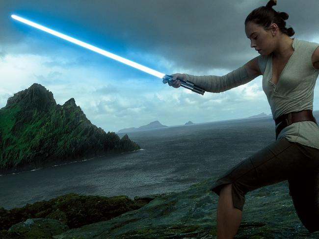 Rey undergoes instruction in the use of her lightsaber in this promotional image for Star Wars: The Last Jedi.