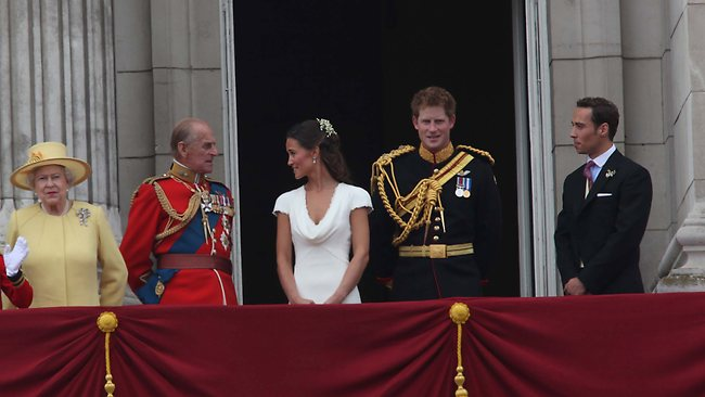 Pippa Middleton shares a joke with Prince Philip. Also on the balcony are the Queen, Prince Harry and Pippa's brother, Andrew. Picture: Tim Anderson
