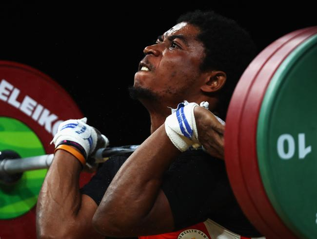Weightlifter Olivier Heracles Matam Matam of Cameroon competes at the Gold Coast 2018 Commonwealth Games abefore his disappearance. Picture: Dean Mouhtaropoulos/Getty Images