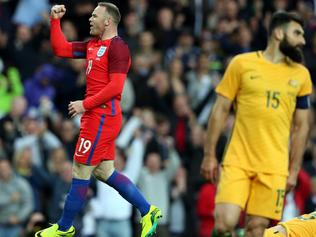 England's Wayne Rooney, centre, celebrates his goal during the international friendly soccer match between England and Australia at the Stadium of Light, Sunderland, England, Friday, May 27, 2016. (AP Photo/Scott Heppell)