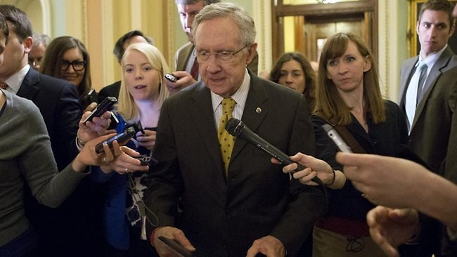 Senate Majority Leader Harry Reid, retreats to a closed-door meeting with fellow Democrats as he and Senate Minority Leader Mitch McConnell, work to negotiate a legislative path to avoid the so-called fiscal cliff. Picture: AP/J. Scott Applewhite