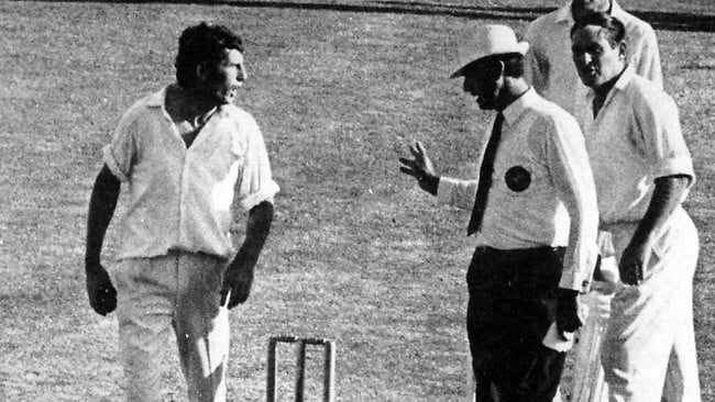 Umpire Lou Rowan argues fast bowler John Snow (L) and captain Ray Ilingworth after an incident in which tail-end batrsman Jenner was assisted from field after being hit by bouncer.
