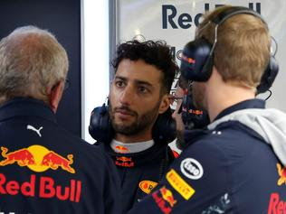 ed Bull's Daniel Ricciardo (2R) is pictured in the pits during the qualifying session at the Silverstone motor racing circuit in Silverstone, central England on July 15, 2017 ahead of the British Formula One Grand Prix. / AFP PHOTO / POOL / ANDREW BOYERS