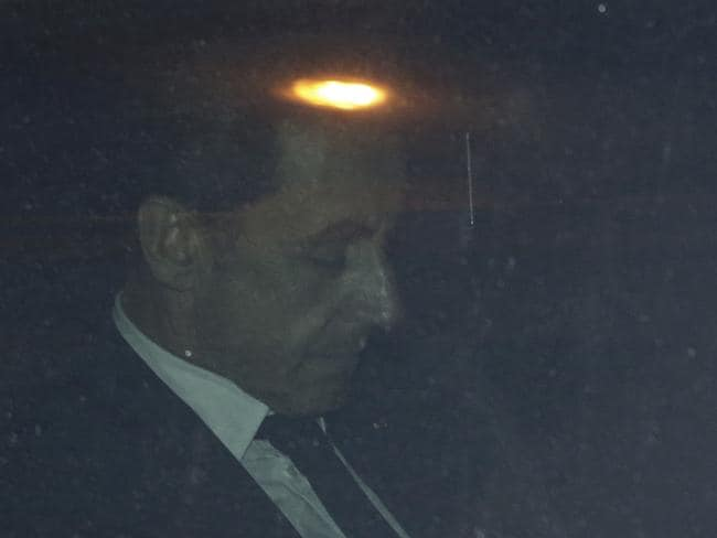 Devastating ... former French President Nicolas Sarkozy leaving the financial crimes section in Paris today charged with corruption and influence peddling in a criminal investigation.