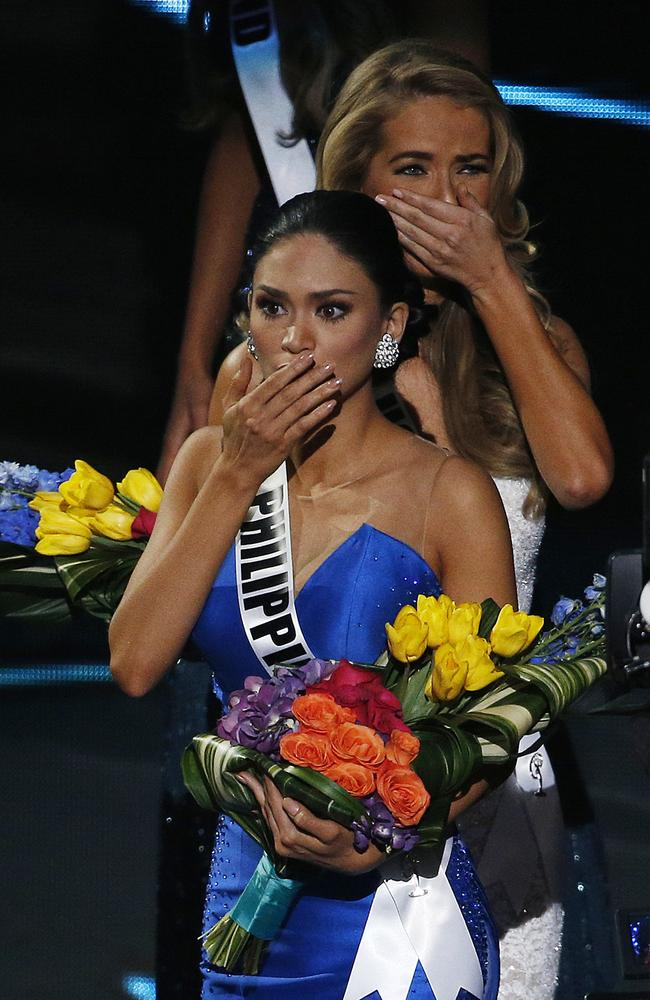 Miss Philippines Pia Alonzo Wurtzbach, front, reacts after she was announced as the new Miss Universe at the Miss Universe pageant. Picture: John Locher/AP Photo.