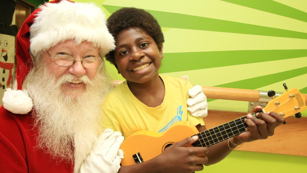 Santas speaks with and provides cheer to 13-year-old Suwa Bowag from PNG. PICTURE: JUSTIN BRIERTY