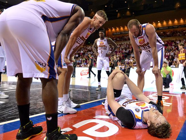 Cameron Bairstow lies in agony on the court after hurting his knee.