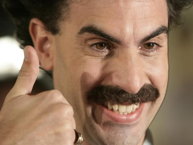"Actor Sacha Baron Cohen arrives in character as Borat Sagdiyev for the film premiere of  'Borat: Cultural Learnings of America for Make Benefit Glorious Nation of Kazakhstan"" in Los Angeles, Oct. 23, 2006. - headshot smiling thumbs /up"