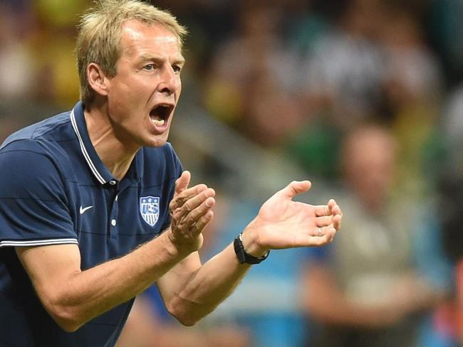 USA coach Jurgen Klinsmann urges his team on.