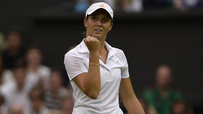 Britain's Laura Robson celebrates reaching match point against Colombia's Mariana Duque-Marino during their second round women's singles match on day five of the 2013 Wimbledon Championships tennis tournament at the All England Club in Wimbledon, southwest London, on June 28, 2013. Robson won 6-4, 6-1. AFP PHOTO / ADRIAN DENNIS - RESTRICTED TO EDITORIAL USE