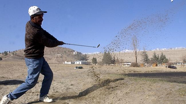 "Well out ... A player takes a shot during a tournament at the Kabul Golf Club, which describes itself as the ""be..."