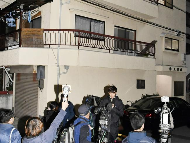 Media outside the apartment where the buckets filled with concrete were found. Picture: AP