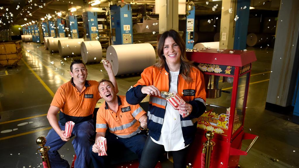 News Corp print centre staff Steve Turner, Trent Reynolds and Katherine Hughes are pumped about NT News' popcorn promotion