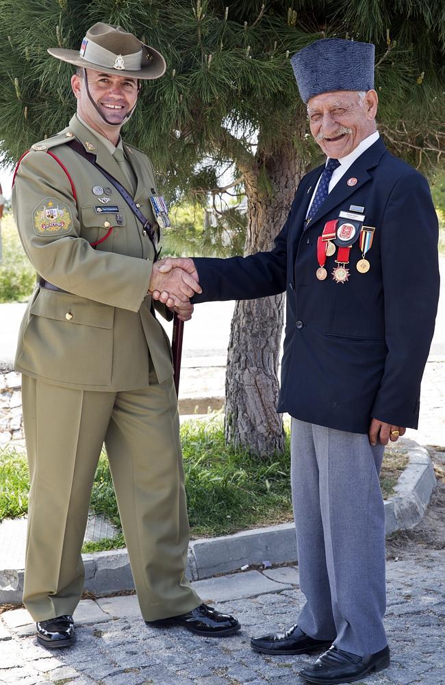 """We are all afriends"" ... Commemorations Regimental Sergeant Major Warrant Officer Paul Richardson shakes hand with Turkish Sergeant Kadir Tekin, who fought in the Korean War. Picture: Ella Pellegrini"