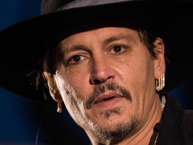 Actor Johnny Depp introduces his film, The Libertine, to the audience at 'Cineramageddon', the outdoor cinema venue, at the Glastonbury Festival of Music and Performing Arts on Worthy Farm near the village of Pilton in Somerset, South West England, on June 22, 2017.  / AFP PHOTO / OLI SCARFF