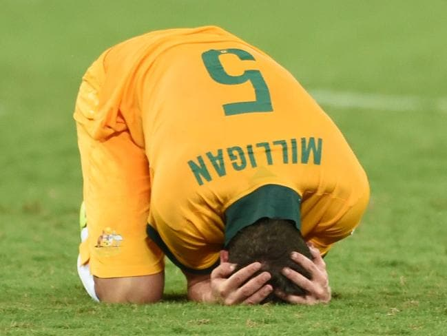 Australia's midfielder Mark Milligan has been ruled out of the World Cup game against Holland.