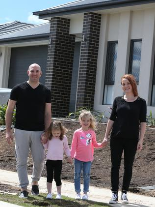 Dario and Lynette Rossotti with daughters Lucrezia and Alizia at their new home.