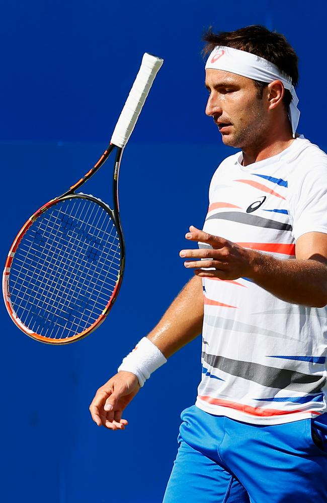 Marinko Matosevic tosses his racquet during his win over Marin Cilic at Queens.