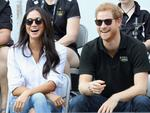 Prince Harry and Meghan Markle talk with a child while attending a Wheelchair Tennis match during the Invictus Games 2017 at Nathan Philips Square on September 25, 2017 in Toronto. Picture: Getty Images.