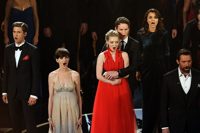 The cast of Les Miserables performs onstage. Picture: AFP
