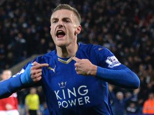 (FILES) This file photo taken on November 28, 2015 shows Leicester City's English striker Jamie Vardy celebrating after scoring during the English Premier League football match between Leicester City and Manchester United at the King Power Stadium in Leicester, central England. Leicester City forward Jamie Vardy has been voted the 2016 Footballer of the Year by the Football Writers' Association (FWA), it was announced on May 2, 2016. / AFP PHOTO / OLI SCARFF