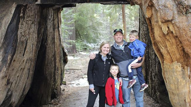 This May 2016 photo provided by Michael Brown shows Sebastian Bull, his wife Amy Bull, and their children Camden and Brady Bull, posing in the Pioneer Cabin tunnel tree, a giant sequoia that had a tunnel carved into it in the 1880s, during a visit to Calaveras Big Trees State Park near Arnold, Calif. The tree was toppled over by a massive storm Sunday, Jan. 8, 2017. Four generations of Brown's family have spent countless hours at the tree and often took out-of-town visitors there, some from as far away as Turkey. (Michael Brown via AP)