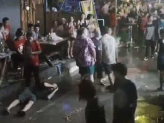 First the son, bottom left, cops a punch to the head. Picture: CCTV Image.