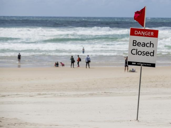 Beaches across the Gold Coast were closed yesterday due to heavy surf conditions. Picture: Jerad Williams
