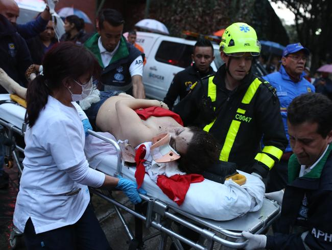 An injured woman is evacuated from the centre. Picture: AP/Ricardo Mazalan