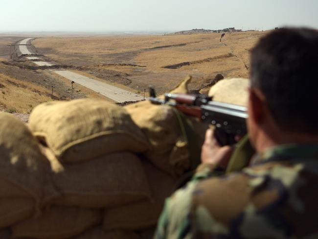 A Kurdish peshmerga soldier aims his rifle toward a road to Mosul as forces continue the battle to retake Mosul. Turkey, which regards most Kurd organisations to be 'terrorists' is insisting it plays a role in the recapture of the city. Picture: Getty